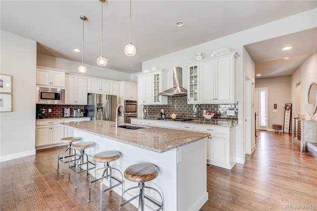 17740 W 94th Drive, Arvada, CO 80007 (#3016372) :: Chateaux Realty Group