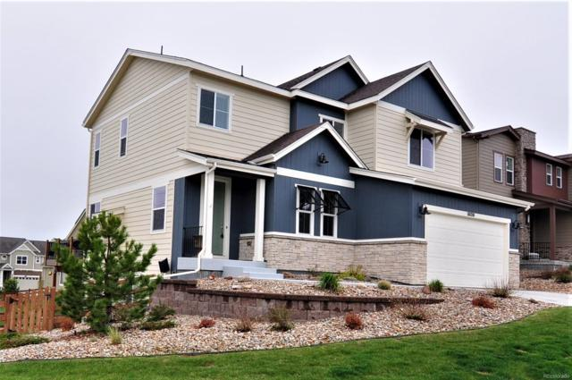 18120 W 84th Place, Arvada, CO 80007 (#3273588) :: The DeGrood Team