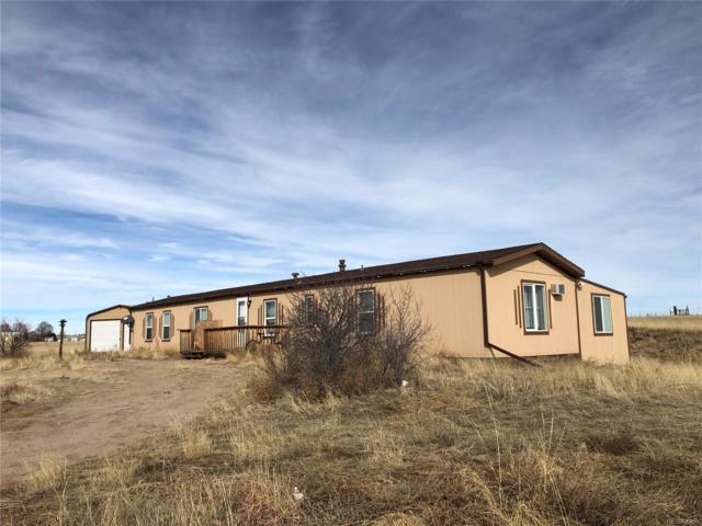 13335 Trail Boss Court, Peyton, CO 80831 (MLS #3390437) :: 8z Real Estate