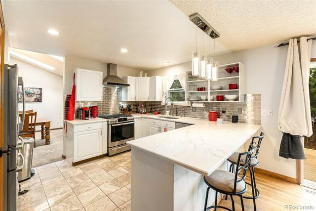 5436 S Simms Way, Littleton, CO 80127 (#3454355) :: The DeGrood Team