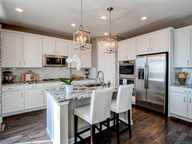 7344 S Oak Hill Court, Aurora, CO 80016 (#3611309) :: The City and Mountains Group