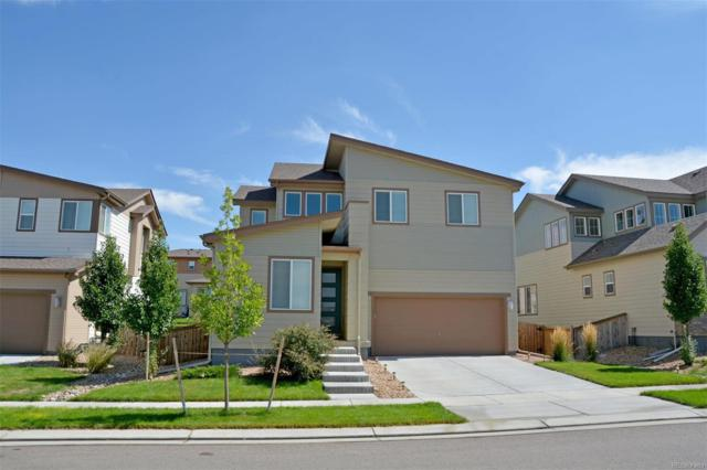 10880 Richfield Circle, Commerce City, CO 80022 (#4037464) :: The DeGrood Team