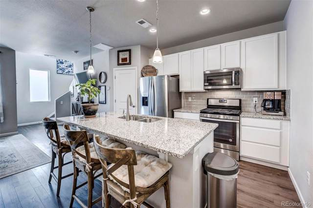 15456 W 64th Loop E, Arvada, CO 80007 (#4102570) :: The Gilbert Group