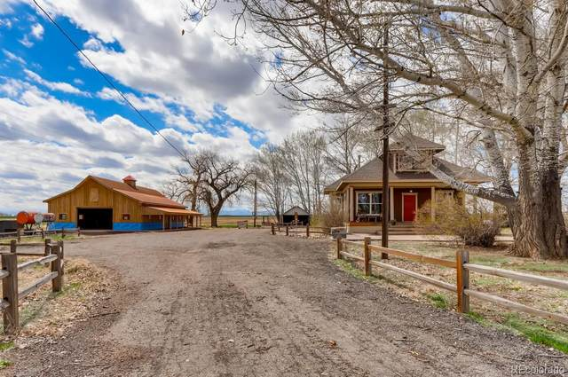 8292 County Rd 6, Brighton, CO 80621 (#4134657) :: The Healey Group