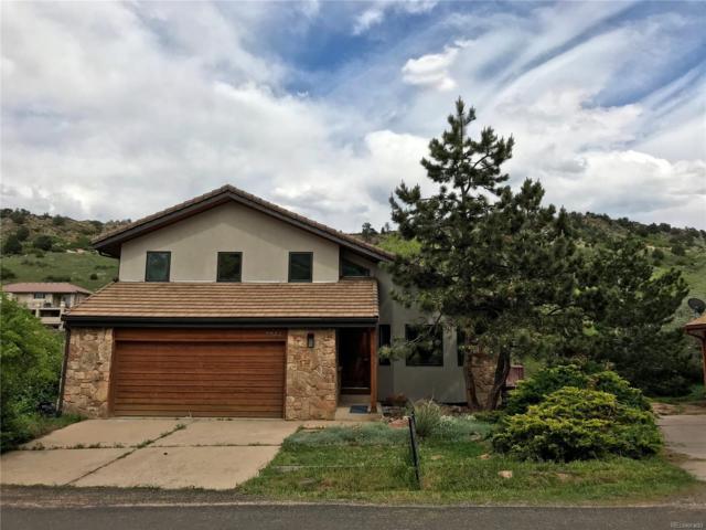 7044 Fox Paw Trail, Littleton, CO 80125 (#4144386) :: Briggs American Properties