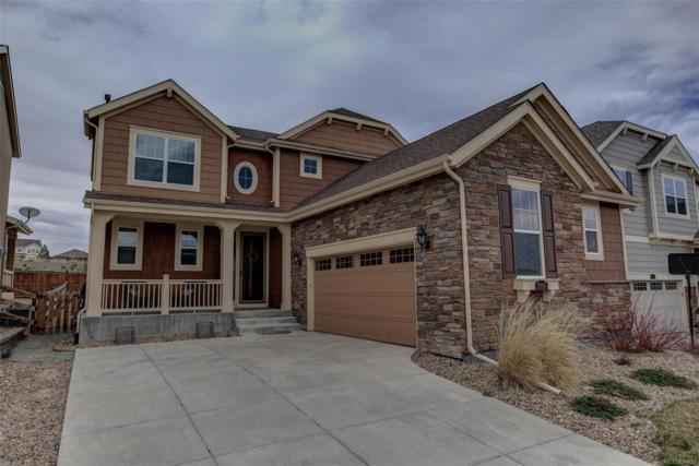 17895 W 84th Lane, Arvada, CO 80007 (#4343701) :: Compass Colorado Realty