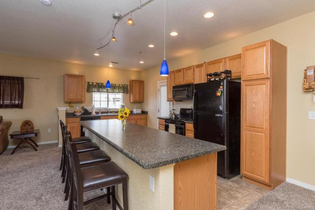 9557 Pearl Circle #203, Parker, CO 80134 (#4349082) :: The DeGrood Team
