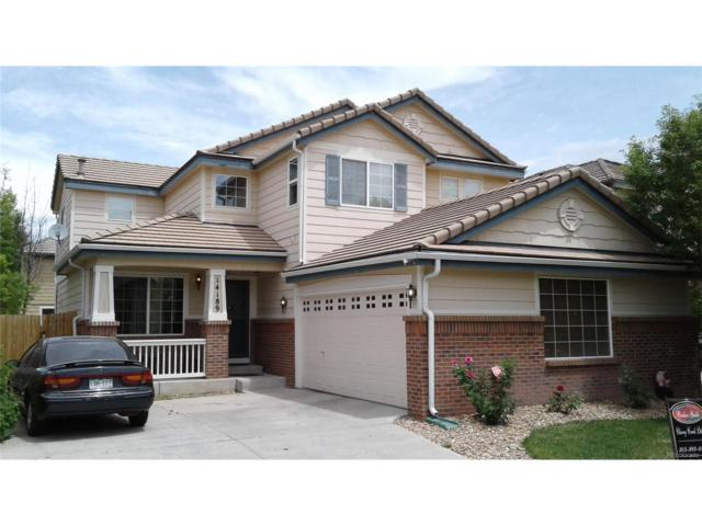 14189 E 101st Place, Commerce City, CO 80022 (#4385098) :: The Peak Properties Group