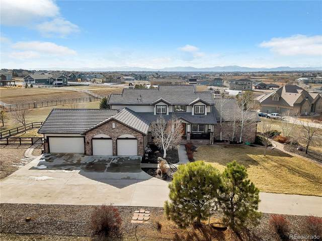 8585 E 127th Court, Brighton, CO 80602 (#4391437) :: The Peak Properties Group