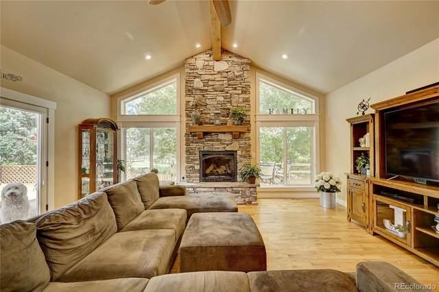 9215 W Wagon Trail Drive, Denver, CO 80123 (#4558846) :: Symbio Denver