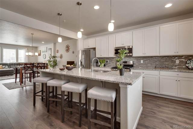 5355 W 97th Avenue, Westminster, CO 80020 (#4592685) :: The Margolis Team