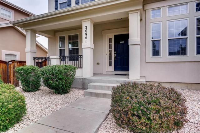 20941 E Greenwood Drive, Aurora, CO 80013 (#4630441) :: The Pete Cook Home Group
