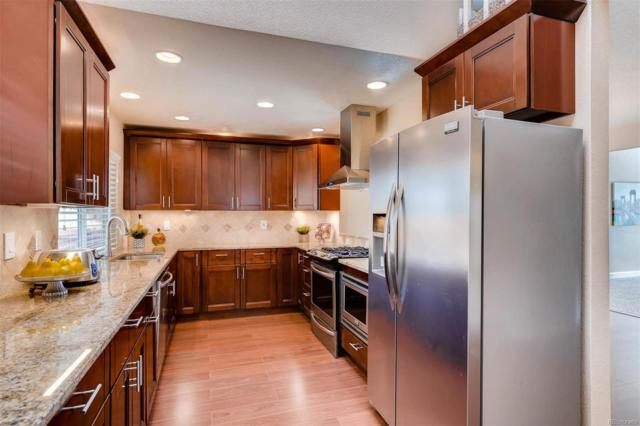 7971 S Quince Way, Centennial, CO 80112 (#4655490) :: The DeGrood Team