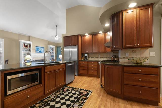 1011 S Valentia Street #100, Denver, CO 80247 (#4694929) :: 5281 Exclusive Homes Realty