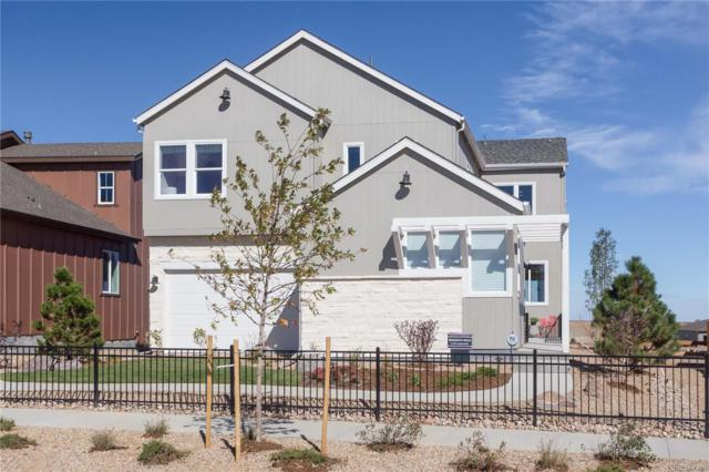 18899 W 92nd Drive, Arvada, CO 80007 (#5304926) :: The Griffith Home Team