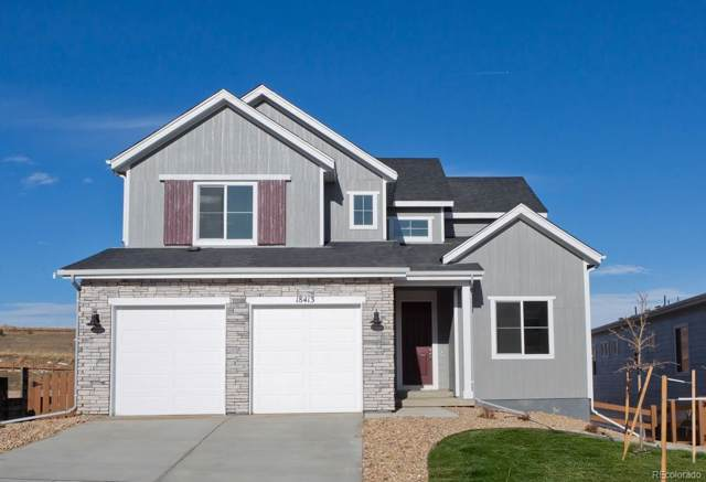 18413 W 94th Lane, Arvada, CO 80007 (#5477464) :: The DeGrood Team