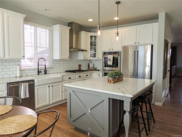 11825 Mobile Street, Commerce City, CO 80022 (#5636637) :: The City and Mountains Group