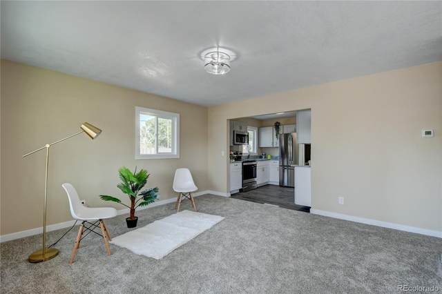 7796 Olive Street, Commerce City, CO 80022 (#5728465) :: The DeGrood Team