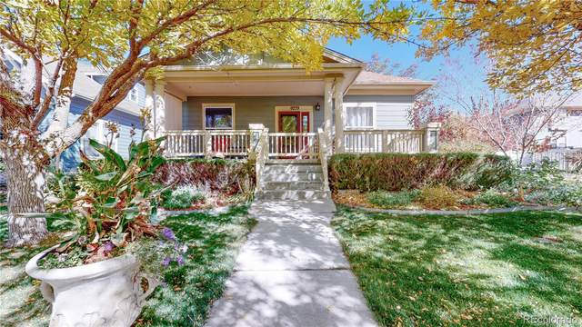 9279 Longs Peak Drive, Commerce City, CO 80640 (#6083783) :: The Scott Futa Home Team