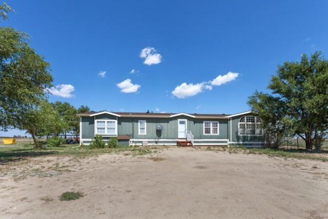 2661 Xmore Road, Byers, CO 80103 (#6188530) :: The DeGrood Team