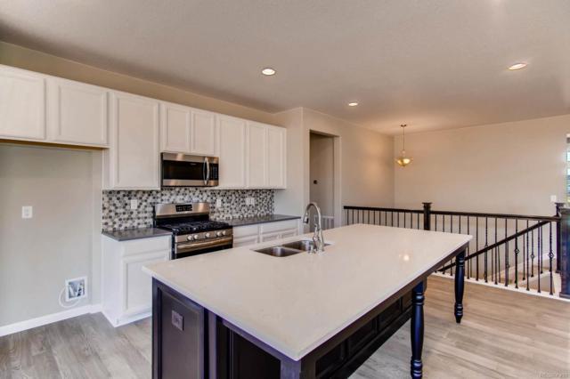 15953 E 112th Place, Commerce City, CO 80022 (#6240913) :: Wisdom Real Estate
