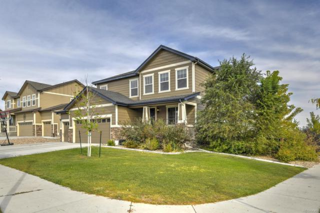 16567 E 99th Place, Commerce City, CO 80022 (#6341966) :: The DeGrood Team