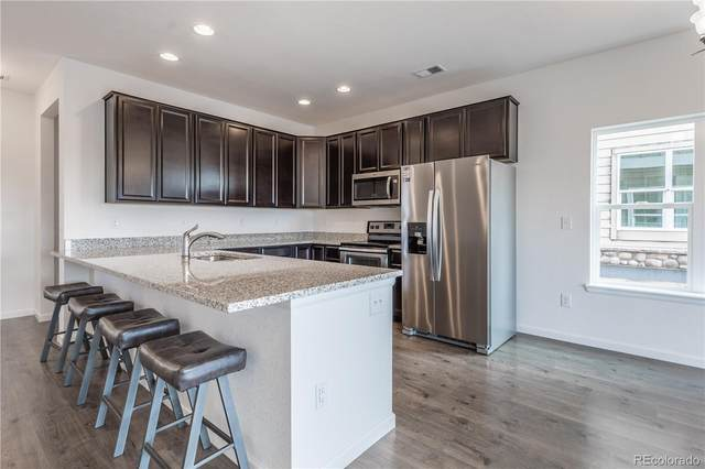 14700 E 104th Avenue #1201, Commerce City, CO 80022 (#6645023) :: Bring Home Denver with Keller Williams Downtown Realty LLC