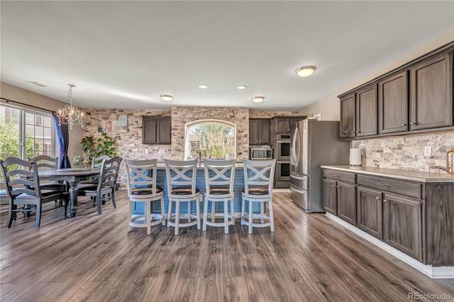 11826 Helena Street, Commerce City, CO 80022 (#6897399) :: Kimberly Austin Properties