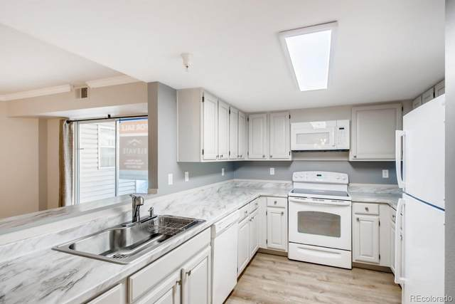 12183 W Cross Drive #102, Littleton, CO 80127 (#7017389) :: Bring Home Denver with Keller Williams Downtown Realty LLC