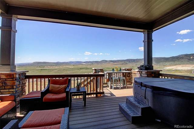 18866 W 87th Lane, Arvada, CO 80007 (#7413423) :: The DeGrood Team