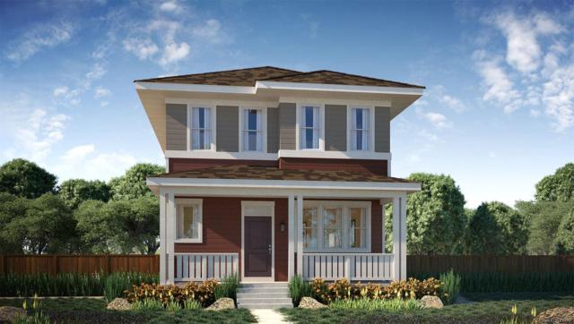 9387 E 59th Avenue, Denver, CO 80238 (#8092387) :: The Griffith Home Team