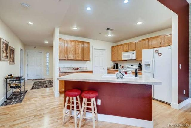 6000 W Floyd Avenue #106, Denver, CO 80227 (#8309133) :: The Healey Group