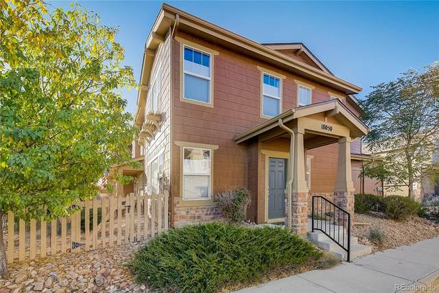 18050 E 104th Place F, Commerce City, CO 80022 (#8341480) :: The DeGrood Team