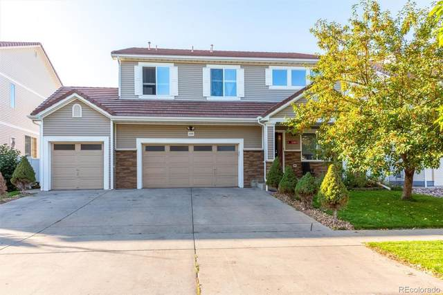 21360 E 48th Place, Denver, CO 80249 (#8426759) :: The DeGrood Team