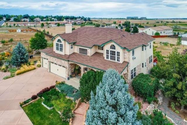 7795 W 106th Avenue, Westminster, CO 80021 (#8672716) :: The Healey Group