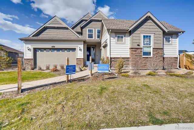 19325 W 94th Avenue, Arvada, CO 80007 (#8726051) :: The Healey Group
