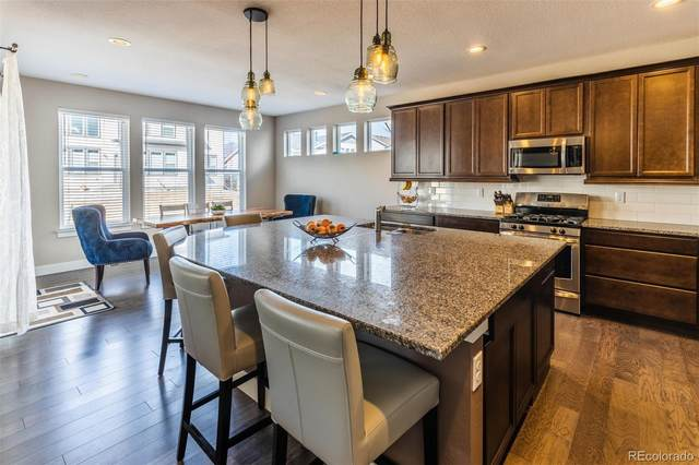 8813 Dunraven Street, Arvada, CO 80007 (#8945138) :: The Brokerage Group