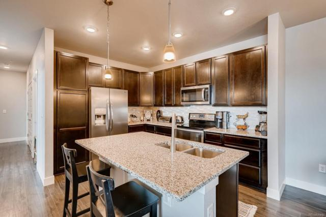 15274 W 64th Lane #308, Arvada, CO 80007 (#9262276) :: My Home Team