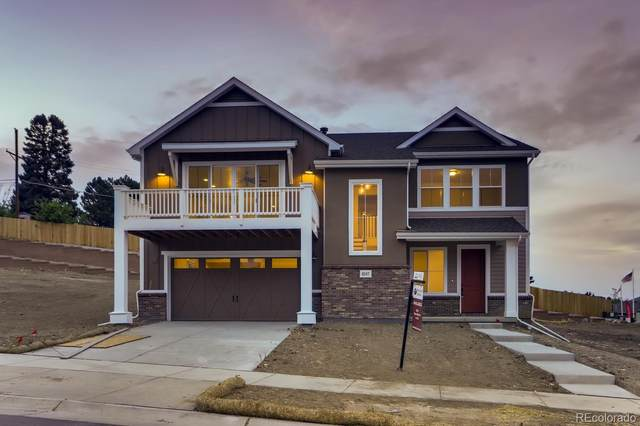 8247 W 66th Drive, Arvada, CO 80004 (#9314059) :: The DeGrood Team