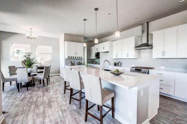 6768 Mariposa Street, Denver, CO 80221 (#1706367) :: The Griffith Home Team