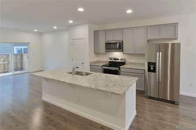 14700 E 104th Avenue #1205, Commerce City, CO 80022 (#3481410) :: Mile High Luxury Real Estate