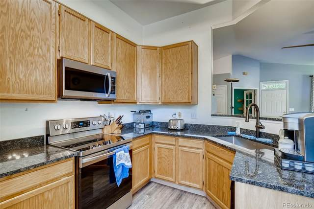 12805 E Wyoming Place, Aurora, CO 80012 (#4009181) :: The Dixon Group