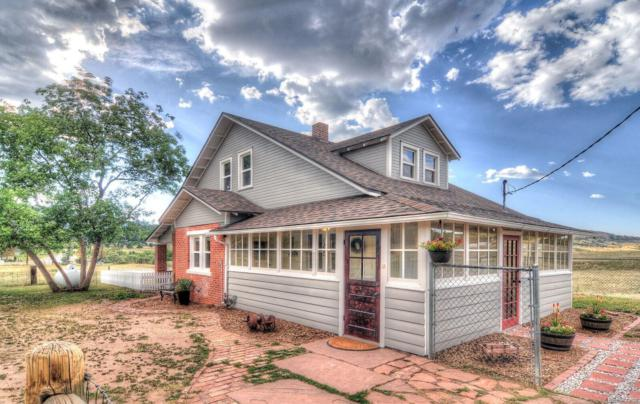 8368 S Perry Park Road, Larkspur, CO 80118 (#4325477) :: The DeGrood Team