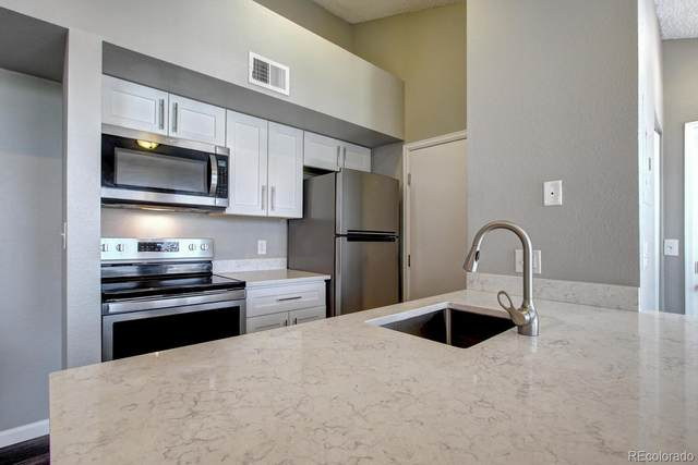 4760 S Wadsworth Boulevard #302, Littleton, CO 80123 (#4446828) :: The Healey Group
