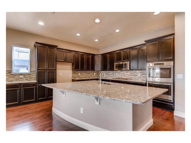 16335 W 84th Lane, Arvada, CO 80007 (MLS #5188441) :: 8z Real Estate