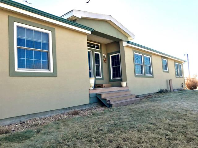 7750 County Road I, Wiggins, CO 80654 (#5882508) :: 5281 Exclusive Homes Realty