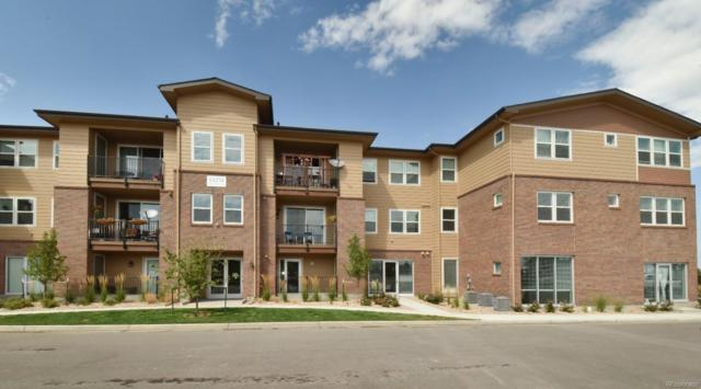 15274 W 64th Lane #102, Arvada, CO 80007 (#6882922) :: The DeGrood Team