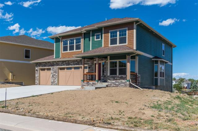 9721 S Crystal Lake Drive, Littleton, CO 80125 (#7452113) :: The DeGrood Team