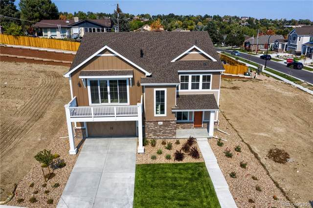 8247 W 66th Drive, Arvada, CO 80004 (#9314059) :: Mile High Luxury Real Estate