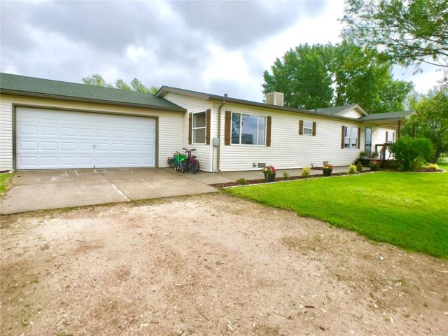 3121 County Road R, Wiggins, CO 80654 (#9533423) :: James Crocker Team